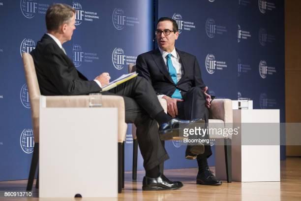 Steven Mnuchin US Treasury secretary right speaks during the Institute of International Finance annual membership meeting in Washington DC US on...