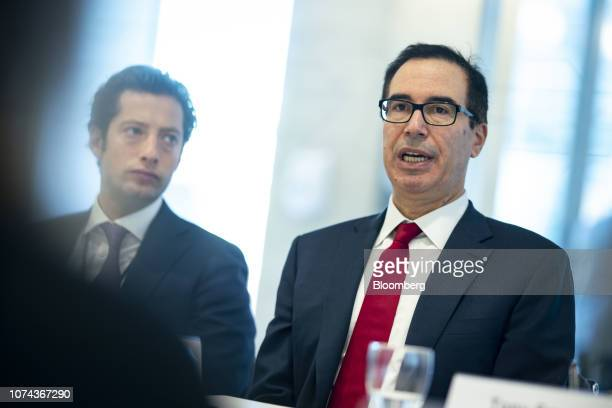 Steven Mnuchin US Treasury secretary right speaks while Eli Miller chief of staff at the US Treasury listens during an interview in Washington DC US...