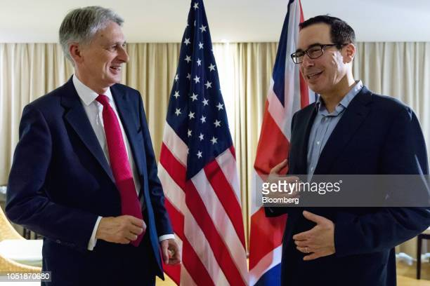 Steven Mnuchin US Treasury secretary right speaks with Philip Hammond UK chancellor of the exchequer at a bilateral meeting on the sidelines of the...