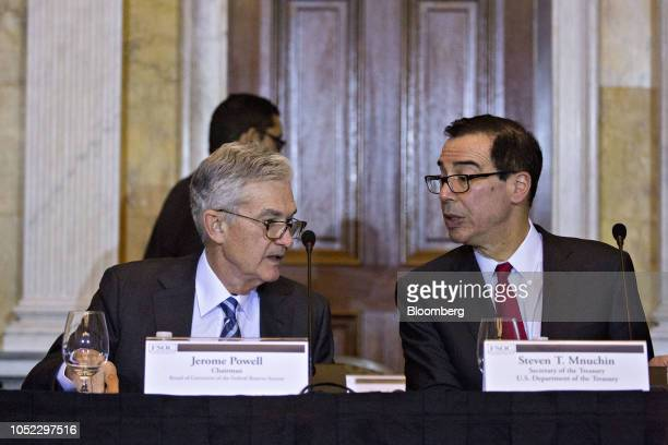 Steven Mnuchin US Treasury secretary right talks to Jerome Powell chairman of the US Federal Reserve during a Financial Stability Oversight Council...