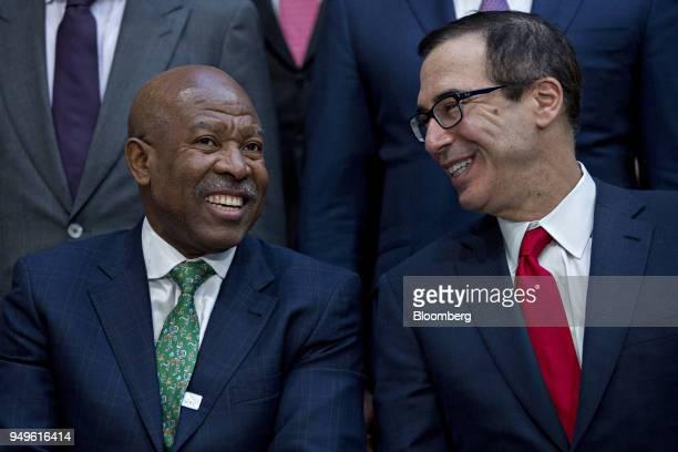 Steven Mnuchin US Treasury secretary right talks to Lesetja Kganyago governor of South Africa's reserve bank during the International Monetary Fund...