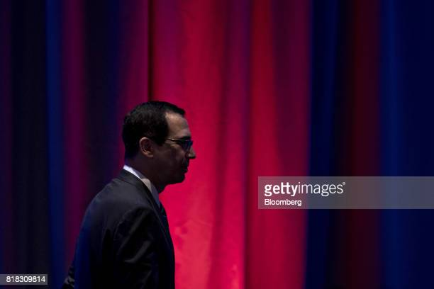 Steven Mnuchin US Treasury secretary walks away after speaking during a reception ahead of the USChina Comprehensive Economic Dialogue meeting in...