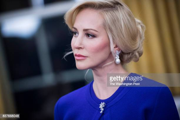 Steven Mnuchin's fiancee Louise Linton listens during a ceremonial swearing in for Treasury secretary in the Oval Office of the White House in...