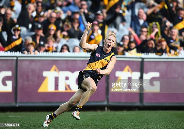 Steven Morris of the Tigers celebrates after kicking a goal during the round 20 AFL match between the Richmond Tigers and the Brisbane Lions at the...