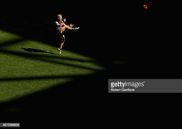 Steven Morris of the Tigers kicks on goal during the NAB Challenge AFL match between the Richmond Tigers and the North Melbourne Kangaroos at Etihad...