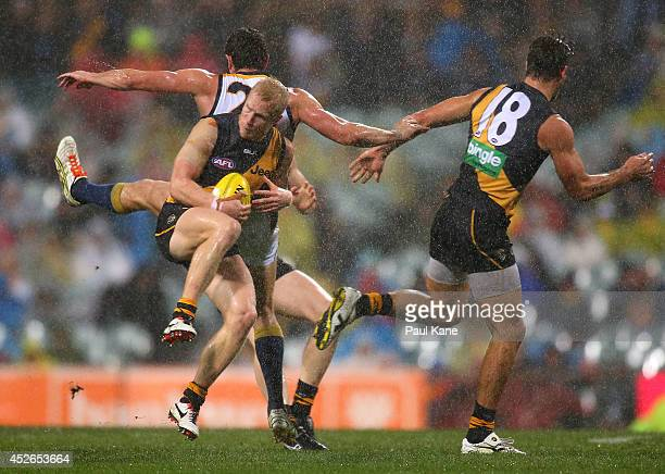 Steven Morris of the Tigers marks the ball against Jack Darling of the Eagles during the round 18 AFL match between the West Coast Eagles and the...