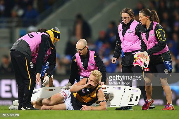 Steven Morris of the Tigers reacts after he suffers a leg injury in a contest with Robin Nahas of the Kangaroos during the round 11 AFL match between...