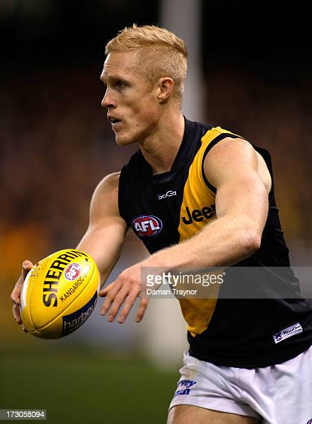 Steven Morris of the Tigers with the ball during the round 15 AFL match between the North Melbourne Kangaroos and the Richmond Tigers at Etihad...