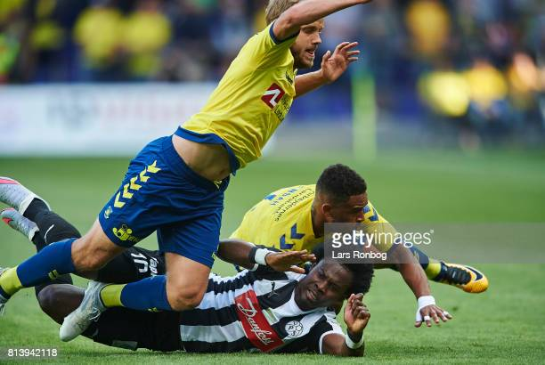 Steven Morrissey of VSP Vaasa Teemu Pukki of Brondby IF and Kevin Mensah of Brondby IF compete for the ball during the UEFA Europa League...