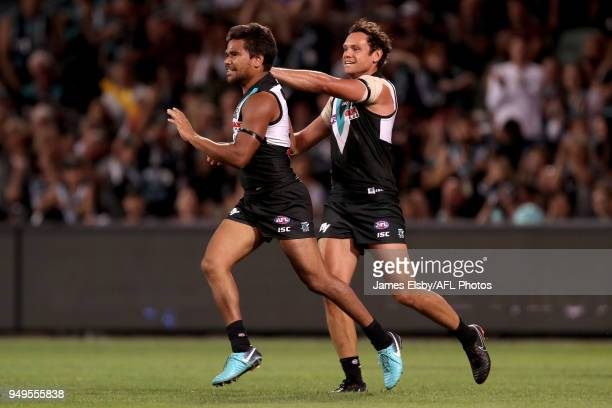 Steven Motlop and Jake Neade of the Power celebrates a goal during the 2018 AFL round five match between the Port Adelaide Power and the Geelong Cats...