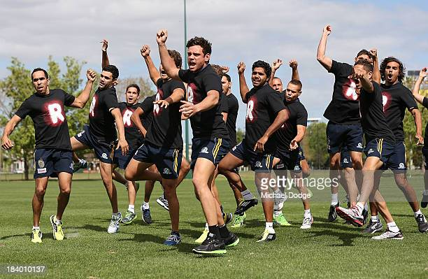 Steven Motlop at the front leads the War Cry performed during an Indigenous Australian International Rules Team training session at Gosch's Paddock...