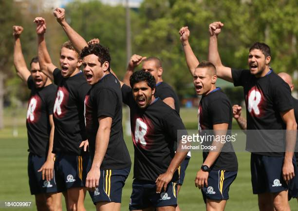 Steven Motlop leads the War Cry performed during an Indigenous Australian International Rules Team training session at Gosch's Paddock on October 11,...