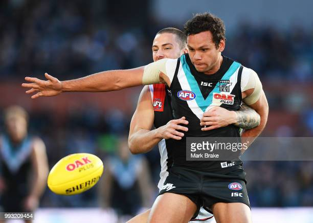 Steven Motlop of Port Adelaide competes with Jarryn Geary of the Saints during the round 16 AFL match between the Port Adelaide Power and the St...