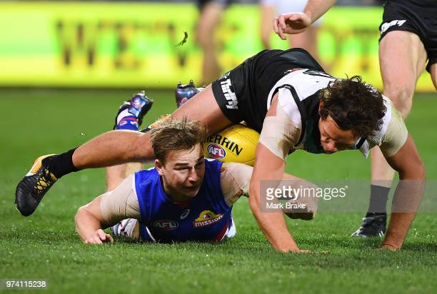 Steven Motlop of Port Adelaide competes with Mitch Honeychurch of the Bulldogs during the round 13 AFL match between Port Adelaide Power and the...