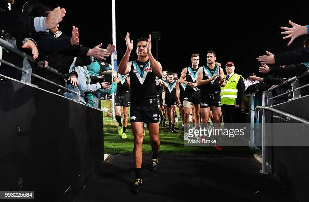Steven Motlop of Port Adelaide leads his team down the race during the round 16 AFL match between the Port Adelaide Power and the St Kilda Saints at...