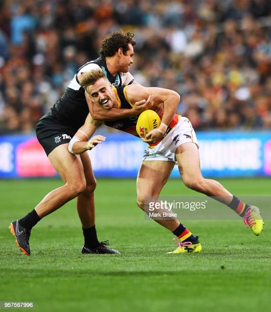 Steven Motlop of Port Adelaide tackles Jordan Gallucci of the Adelaide Crows during the round eight AFL match between the Port Adelaide Power and the...