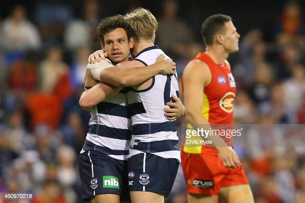 Steven Motlop of the Cats celebrates a goal with team mate Josh Caddy during the round 14 AFL match between the Gold Coast Suns and the Geelong Cats...