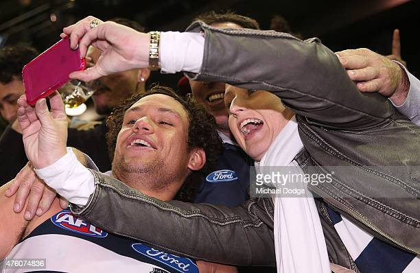 Steven Motlop of the Cats celebrates the win with fans during the round 10 AFL match between the Essendon Bombers and the Geelong Cats at Etihad...