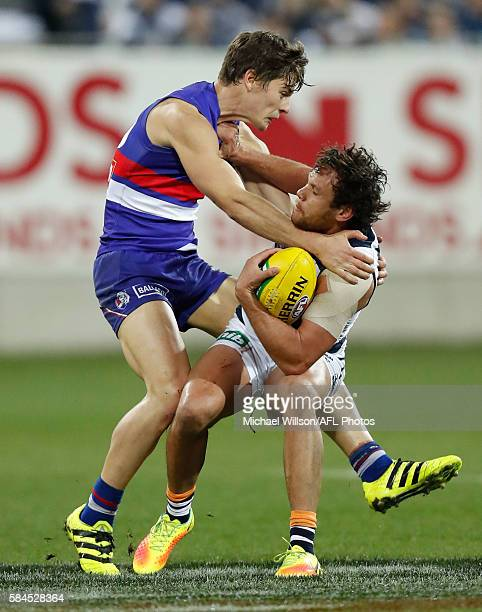 Steven Motlop of the Cats is tackled by Josh Dunkley of the Bulldogs during the 2016 AFL Round 19 match between the Geelong Cats and the Western...