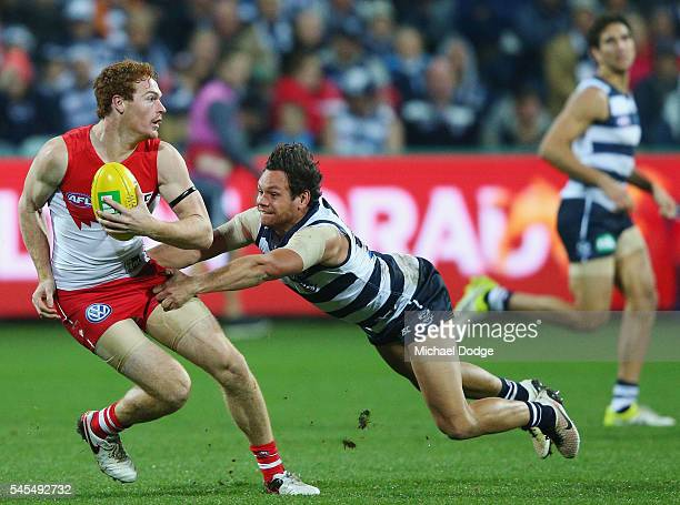 Steven Motlop of the Cats tackes Gary Rohan of the Swans during the round 16 AFL match between the Geelong Cats and the Sydney Swans at Simonds...