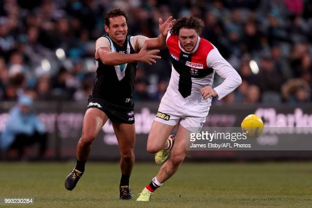 Steven Motlop of the Power competes with Jack Steven of the Saints during the 2018 AFL round 16 match between the Port Adelaide Power and the St...