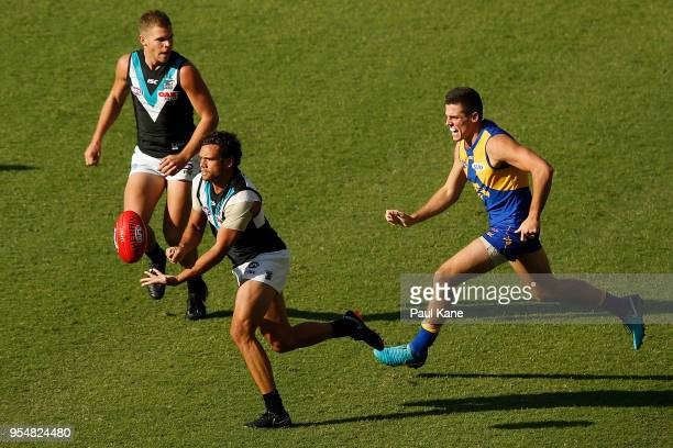 Steven Motlop of the Power looks to handball during the round seven AFL match between the West Coast Eagles and the Port Adelaide Power at Optus...