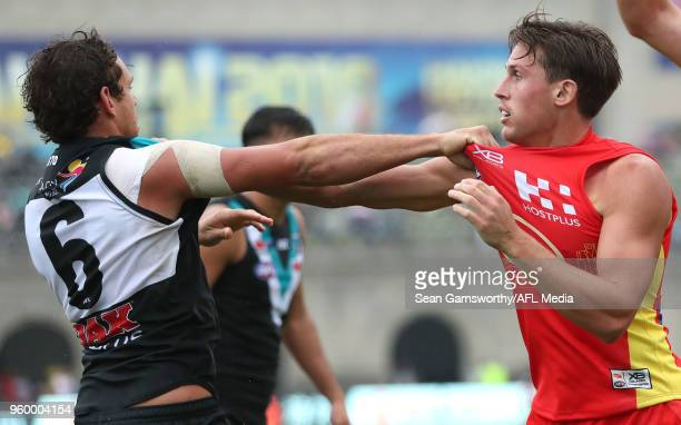 Steven Motlop of the Power wrestles with David Swallow of the Suns during the 2018 AFL round nine match between the Gold Coast Suns and the Port...