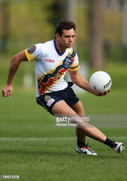 Steven Motlop runs with the ball during an Indigenous Australian International Rules Team training session at Gosch's Paddock on October 11, 2013 in...