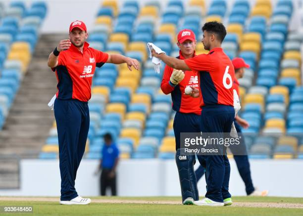 Steven Mullaney and Alex Davies of North sets the field for Brett D'Oliveira during the ECB North v South Series match One at Kensington Oval on...