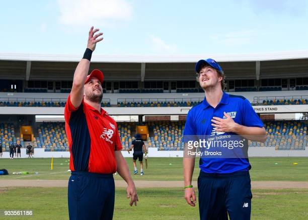 Steven Mullaney of North toss the coin as Sam Northeast of South looks on at the start of the ECB North v South Series match One at Kensington Oval...