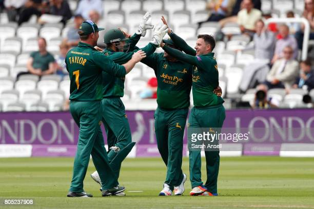 Steven Mullaney of Nottinghamshire celebrates after taking the wicket of Surrey's Kumar Sangakkara during the match between Nottinghamshire and...