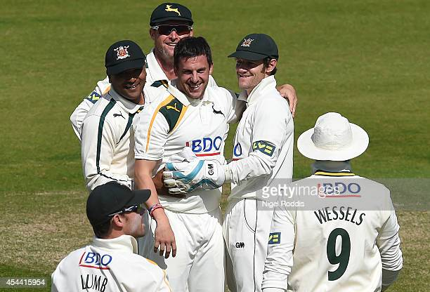 Steven Mullaney of Nottinghamshire celebrates with teamates after taking the wicket of Mark Stoneman of Durham during the LV County Championship...