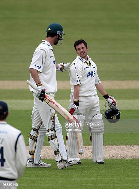 Steven Mullaney of Nottinghamshire celebrates with teammate Charlie Shreck after reaching his century during the LV County Championship match between...