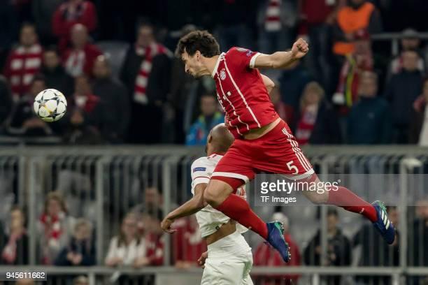 Steven N Zonzi of Sevilla and Mats Hummels of Muenchen battle for the ball during the UEFA Champions League quarter final second leg match between...