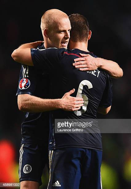Steven Naismith and Shaun Maloney of Scotland celebrate victory after the EURO 2016 Group D Qualifier match between Scotland and Republic of Ireland...