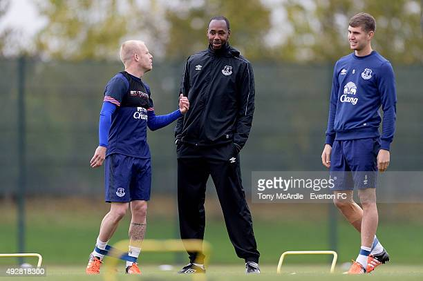 Steven Naismith Dennis Lawrence first team coach and John Stones during the Everton training session at Finch Farm on October 15 2015 in Halewood...