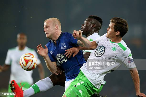 Steven Naismith of Everton and Sebastian Jung of VfL Wolfsburg compete for the ball during the UEFA Europa League Group H match between Everton and...