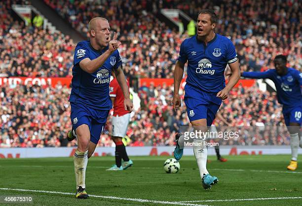 Steven Naismith of Everton celebrates scoring his team's first goal during the Barclays Premier League match between Manchester United and Everton at...