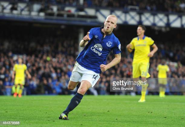 Steven Naismith of Everton celebrates scoring his team's second goal during the Barclays Premier League match between Everton and Chelsea at Goodison...