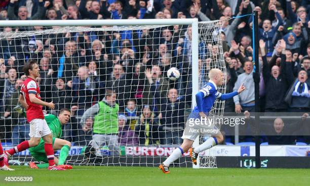 Steven Naismith of Everton celebrates scoring the first goal during the Barclays Premier League match between Everton and Arsenal at Goodison Park on...
