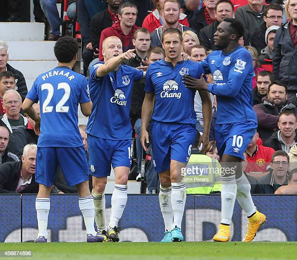 Steven Naismith of Everton celebrates scoring their first goal during the Barclays Premier League match between Manchester United and Everton at Old...