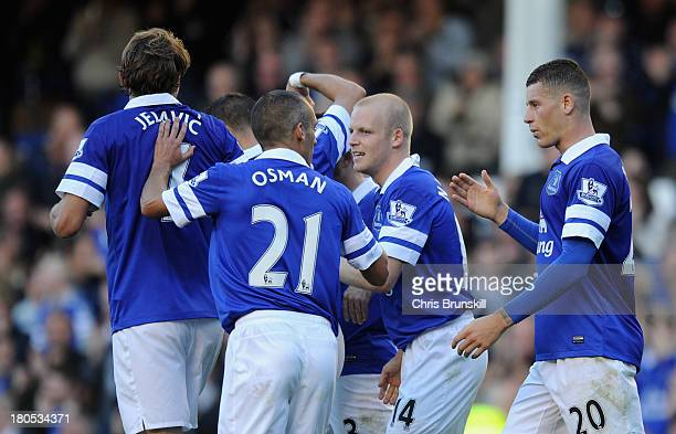 Steven Naismith of Everton celebrates wit his teammates after scoring the opening goal during the Barclays Premier League match between Everton and...