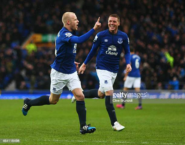 Steven Naismith of Everton celebrates with James McCarthy as he scores their first goal during the Barclays Premier League match between Everton and...