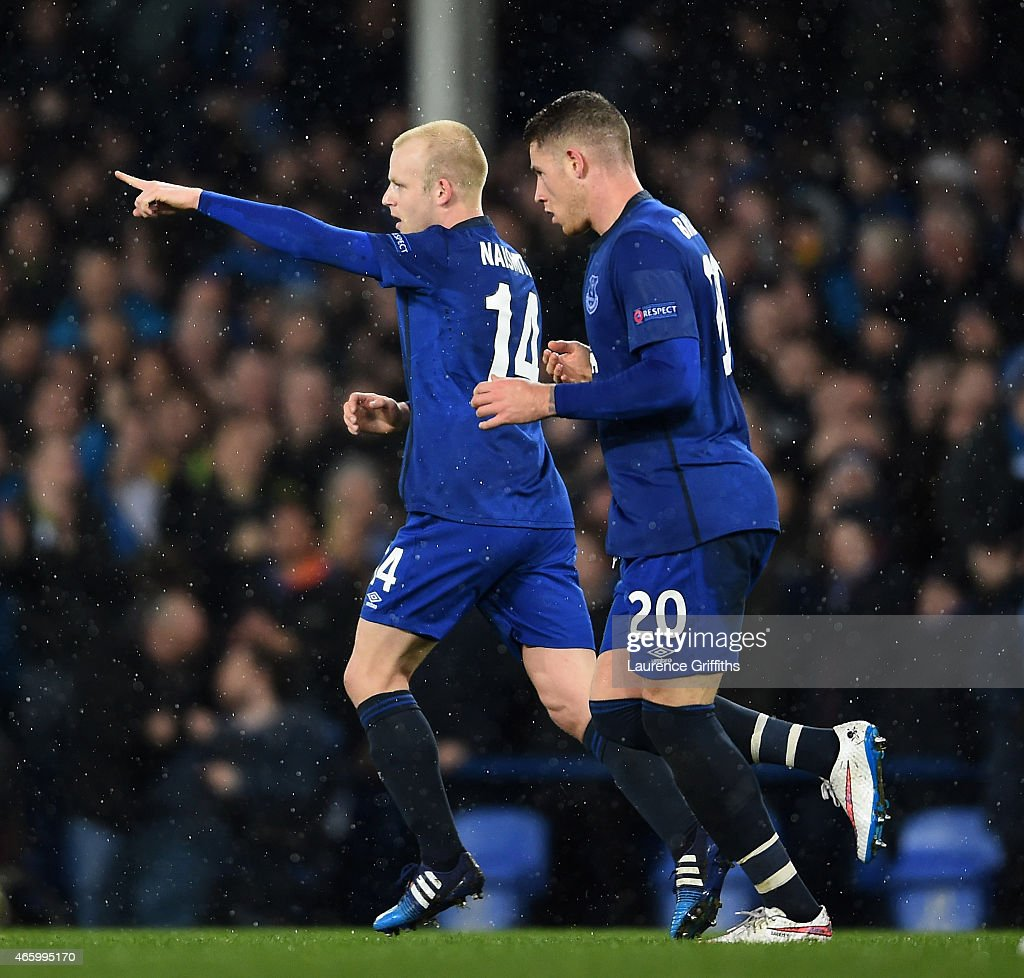 Steven Naismith of Everton celebrates with teammate Ross Barkley #20 after scoring a goal to level the scores at 1-1 during the UEFA Europa League Round of 16, first leg match between Everton and FC Dynamo Kyiv at Goodison Park on March 12, 2015 in Liverpool, United Kingdom.