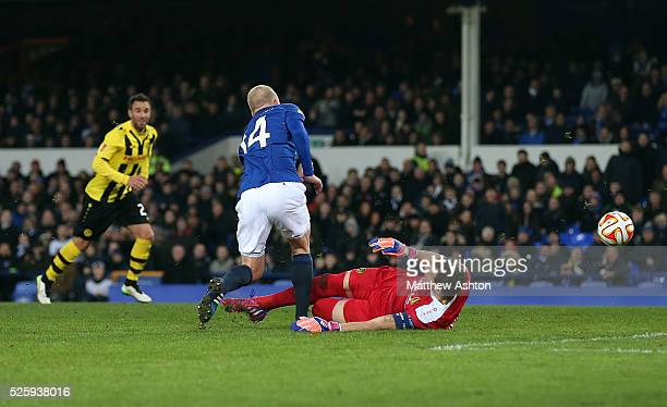 Steven Naismith of Everton is brought down by Marco Wolfli of Young Boys for a penalty