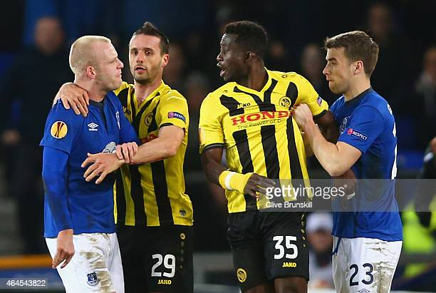 Steven Naismith of Everton is held back by Raphael Nuzzolo of BSC Young Boys as he clashes with Sekou Sanogo Junior of BSC Young Boys who is held...