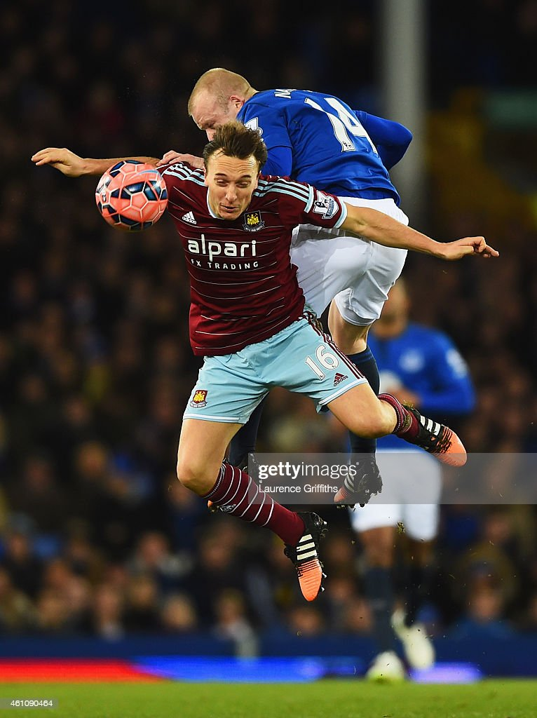 Steven Naismith of Everton outjumps Mark Noble of West Ham United during the FA Cup Third Round match between Everton and West Ham United at Goodison Park on January 6, 2015 in Liverpool, England.