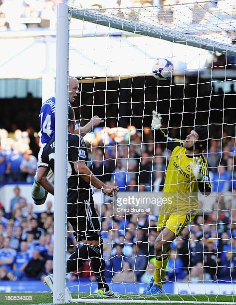 Steven Naismith of Everton scores the opening goal during the Barclays Premier League match between Everton and Chelsea at Goodison Park on September...