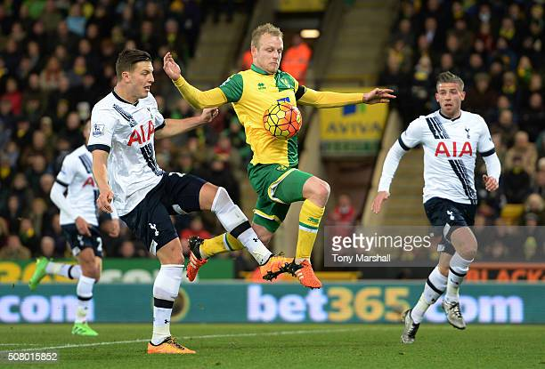 Steven Naismith of Norwich City and Kevin Wimmer of Tottenham Hotspur compete for the ball during the Barclays Premier League match between Norwich...