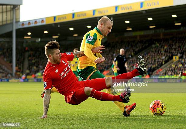 Steven Naismith of Norwich City is fouled by Alberto Moreno of Liverpool resulting in the penalty kick during the Barclays Premier League match...